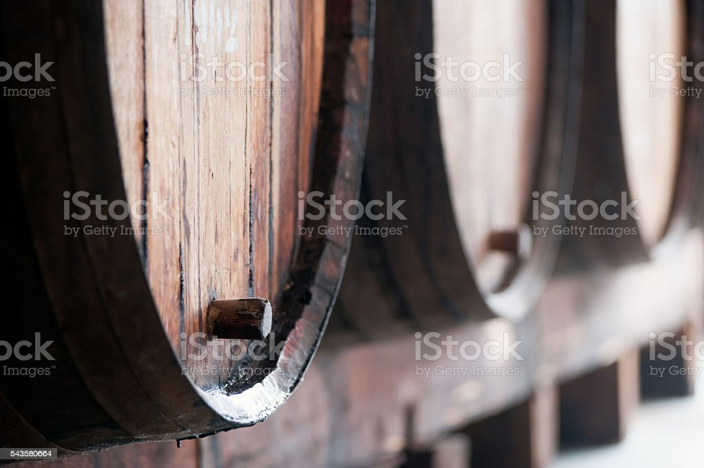 Many old wine barrels in the wine cellar, Madeira island. stock photo