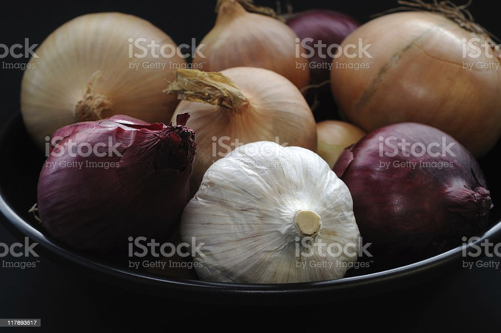 Many Onions and one Garlic royalty-free stock photo