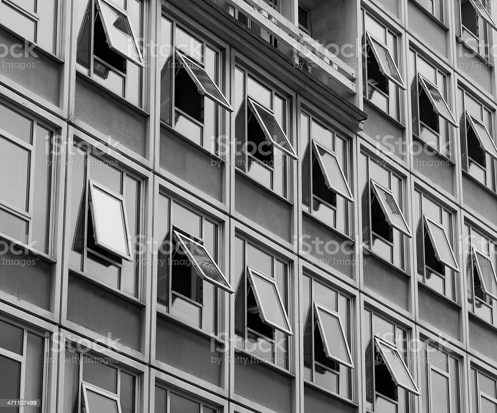 Many open windows in an office block. royalty-free stock photo