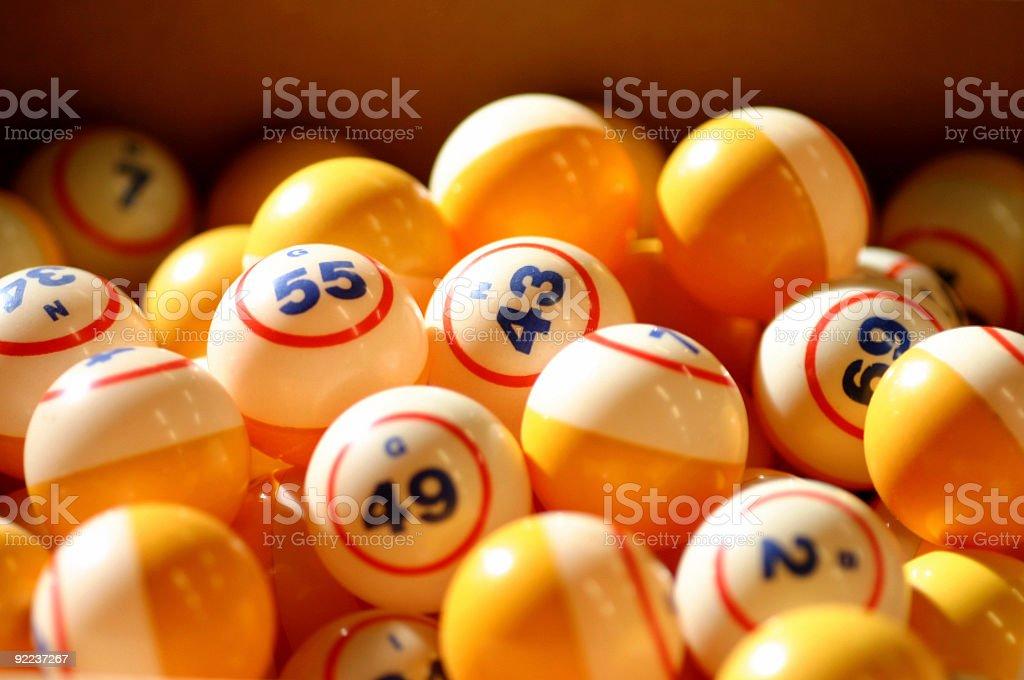 Many orange and white bingo balls stock photo