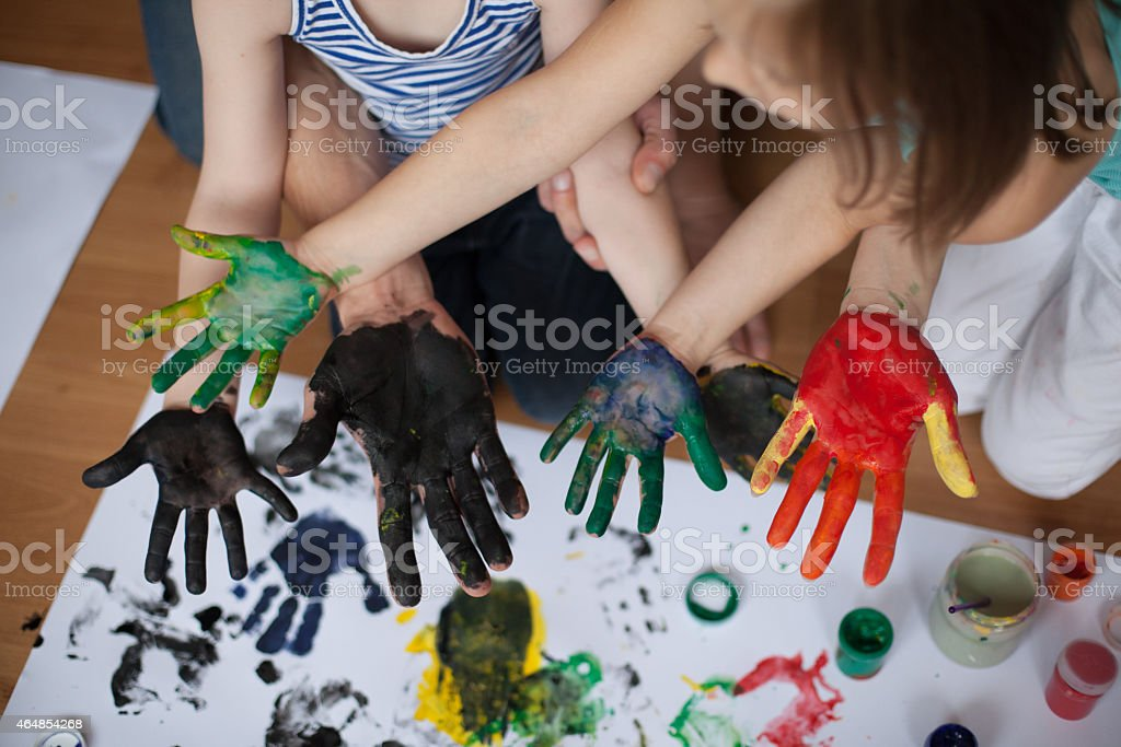 Many painted hands stock photo