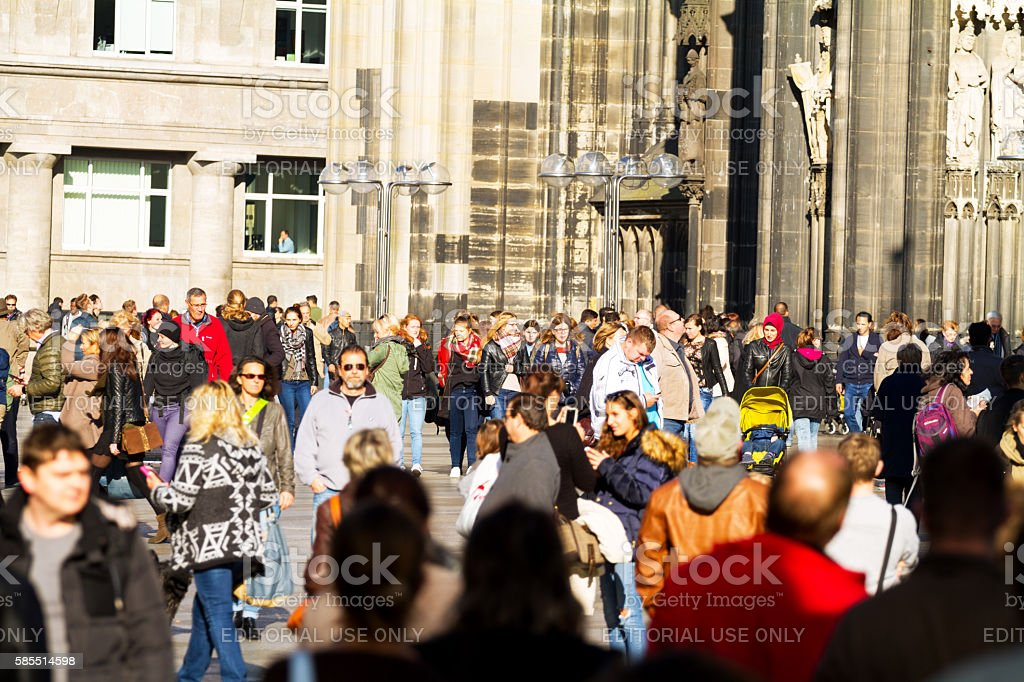 Many people and tourists at Cologne cathedral stock photo