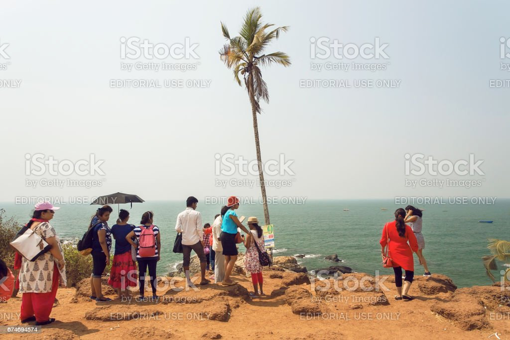Many people coming to ocean beach for relaxing holidays with families stock photo