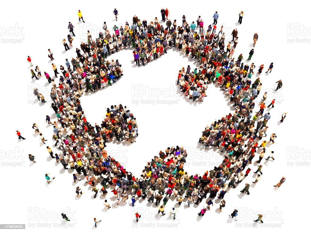 Many people forming a giant puzzle piece stock photo