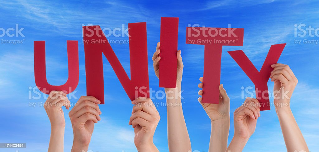 Many People Hands Holding Red Word Unity Blue Sky stock photo