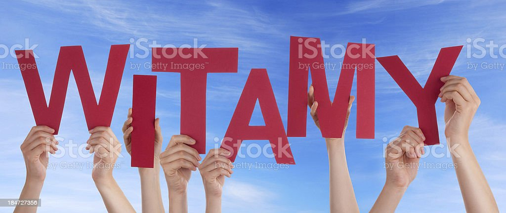 Many People Holding Red Witamy royalty-free stock photo