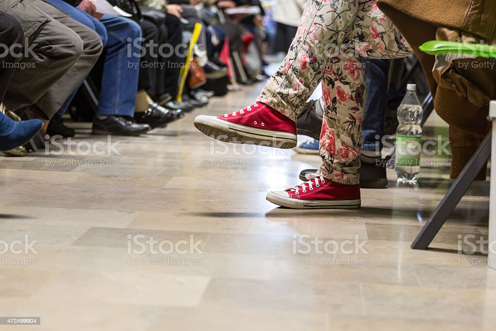 Many people in a waiting room stock photo