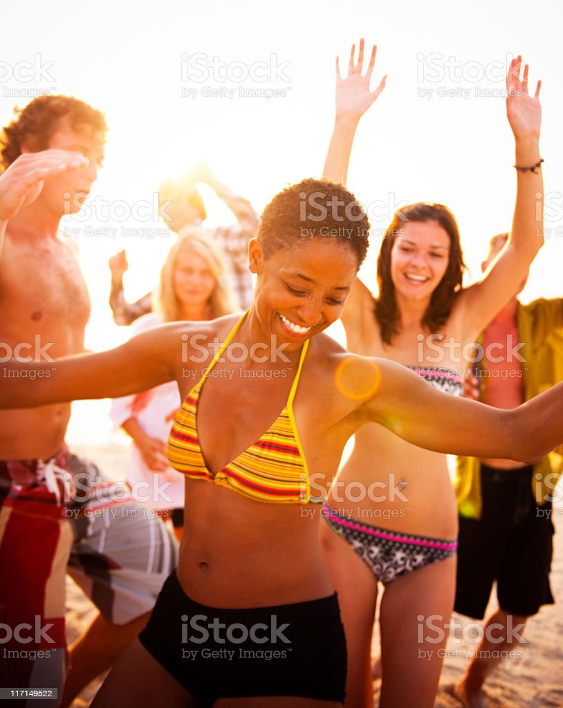 Many people in bathing suits dancing at a summer beach party royalty-free stock photo