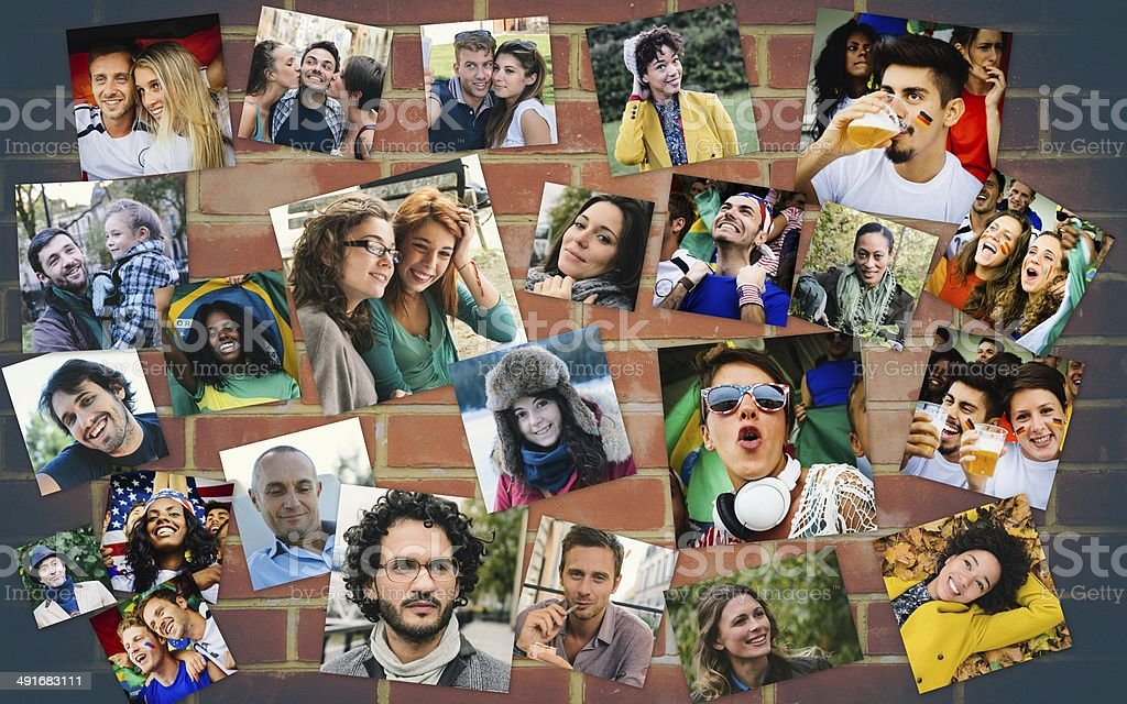 Many people portrait on a brick wall stock photo