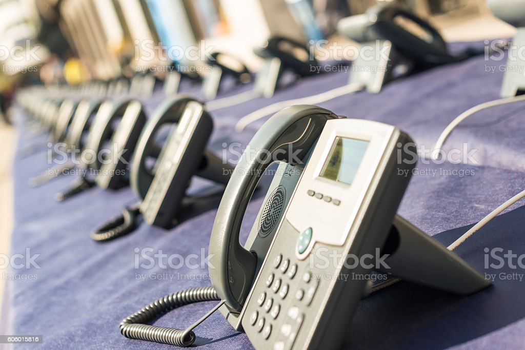 Many phones in two straight rows stock photo