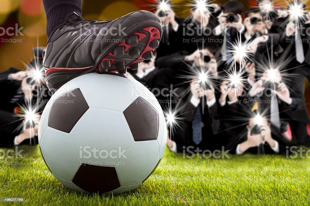 many photographer taking winner soccer player feet stock photo