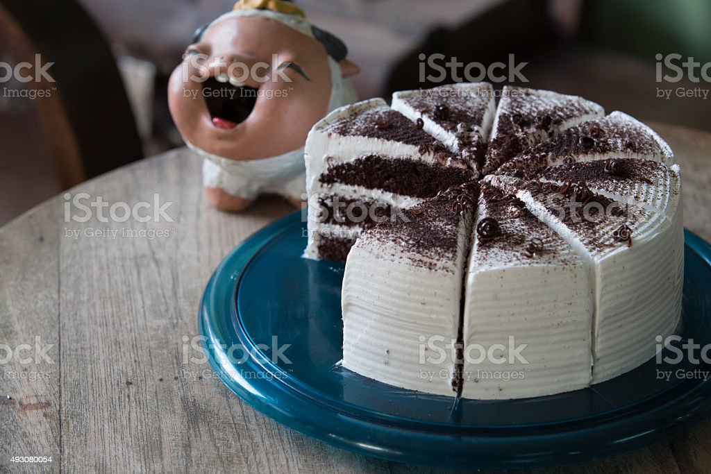 many pieces of white chocolate cake on blue plastic tray stock photo