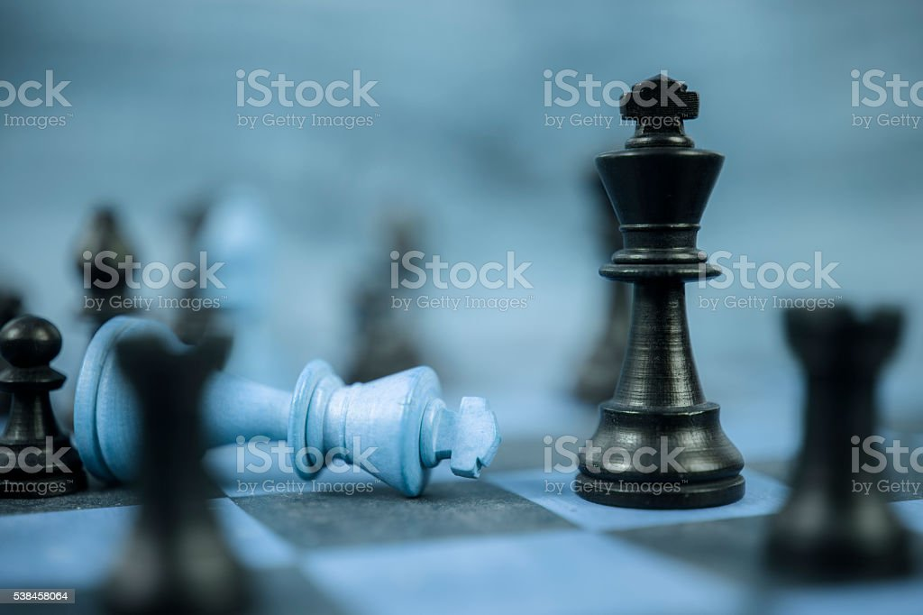 Many pieces on chess game board.  Kings. Checkmate.  Strategy concept. stock photo