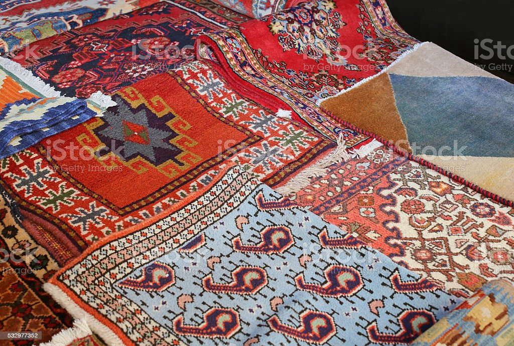 many precious ancient colored wool rugs stock photo