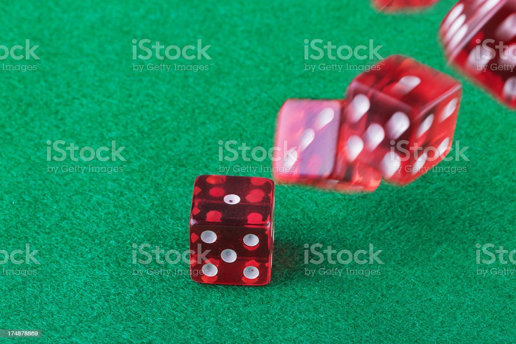 Many red dice freefalling stock photo
