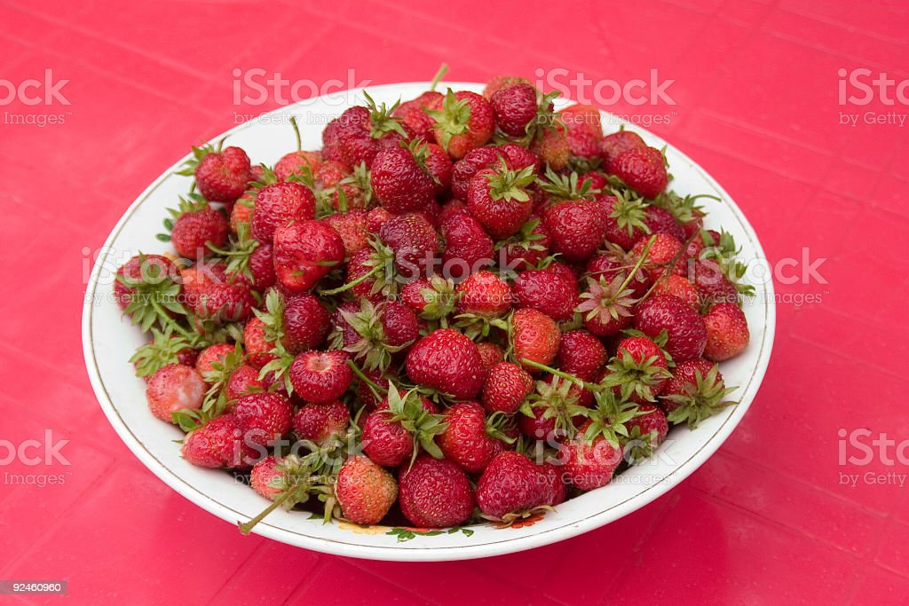 Many red ripe strawberries stock photo