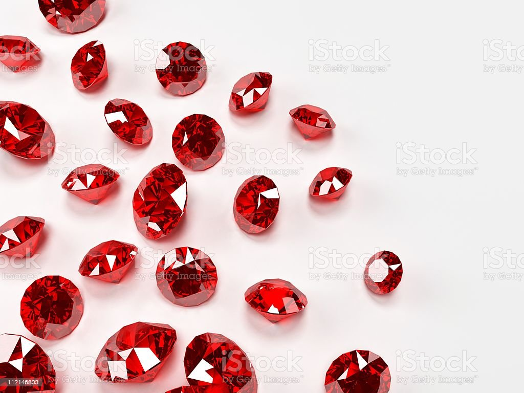 Many red rubies on a white surface stock photo