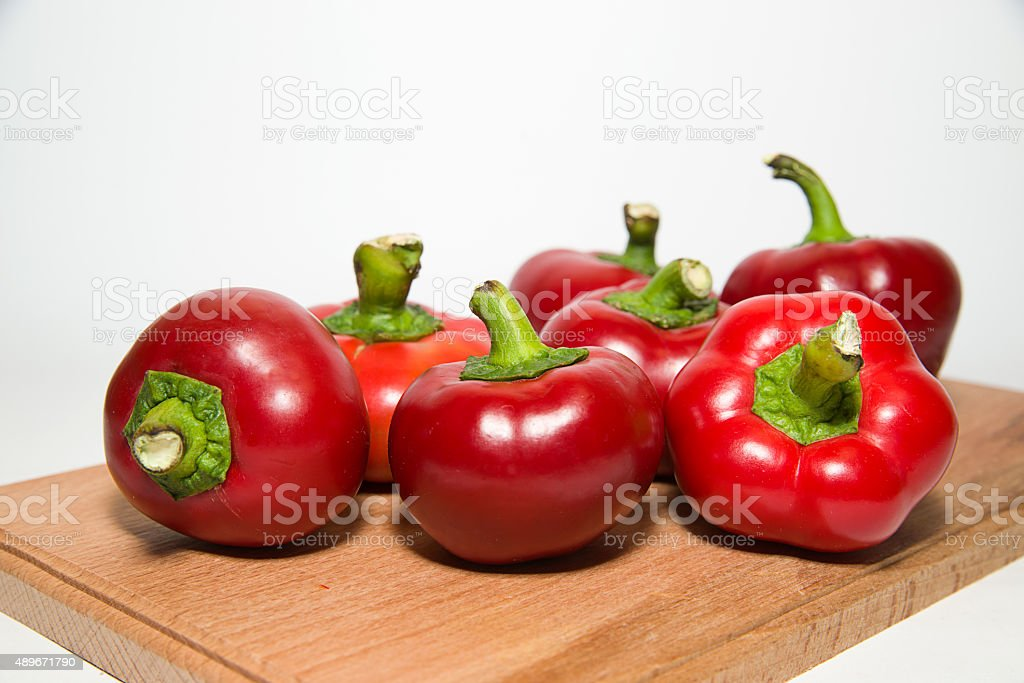 Many ripe red peppers on over white stock photo