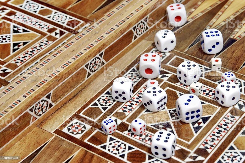 Many roll dices on backgammon board stock photo