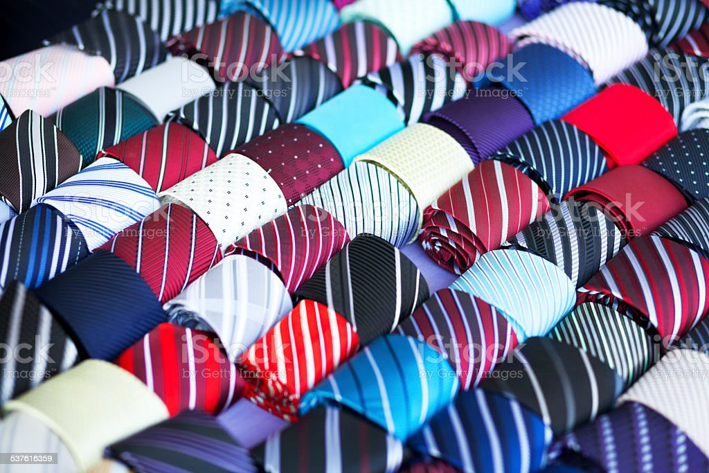 Many rolled thai silk ties stock photo