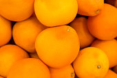 Many round whole oranges as a background