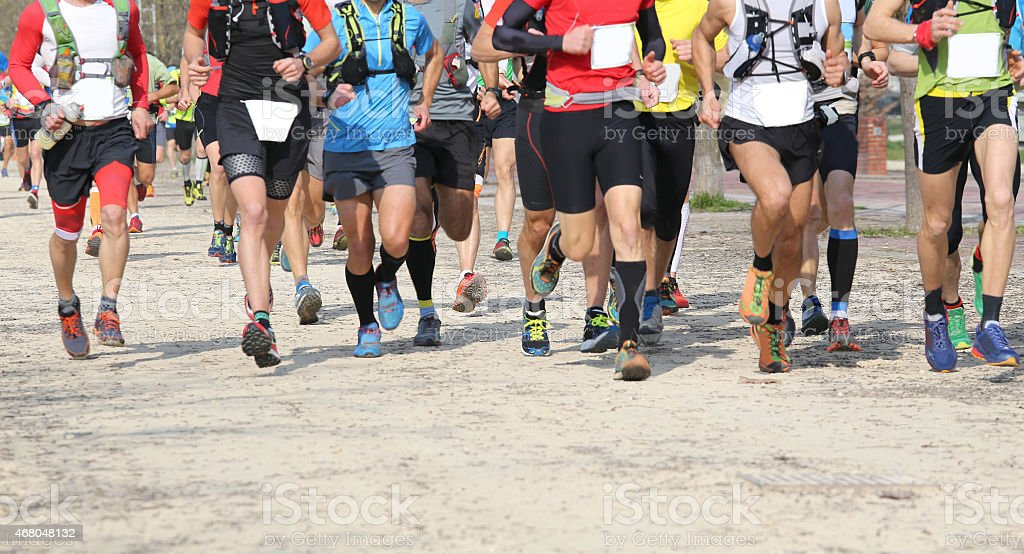 many runners involved in the outdoor race stock photo