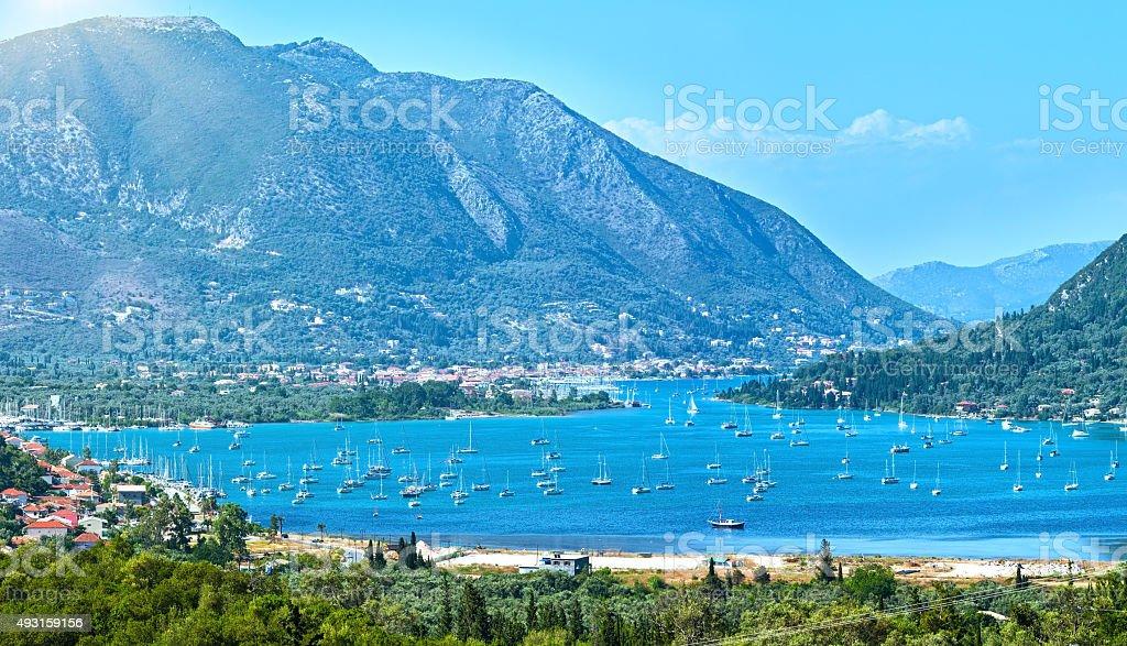 Many sailing vessels in bay (Nydri, Lefkada, Greece) stock photo
