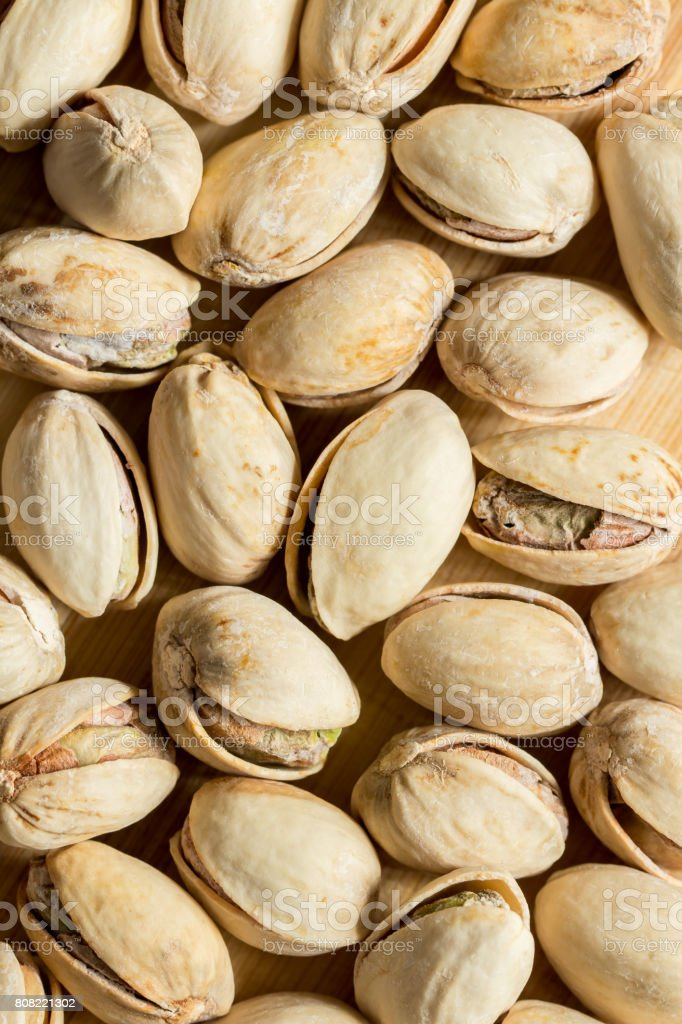 Many salt pistachio nuts full screen top view stock photo