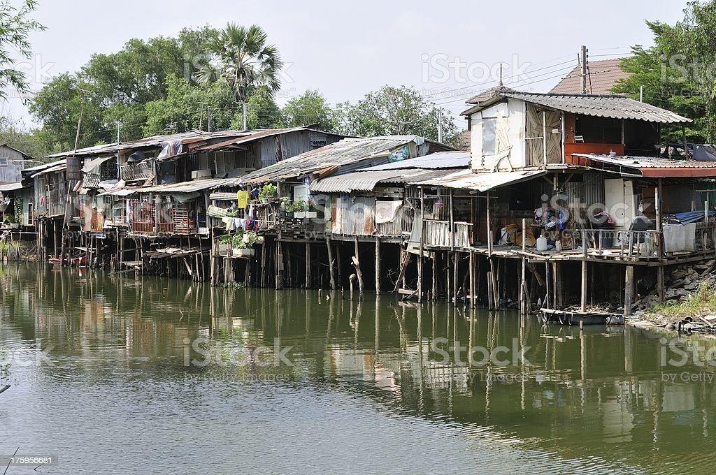 Many slum houses near a water canal royalty-free stock photo