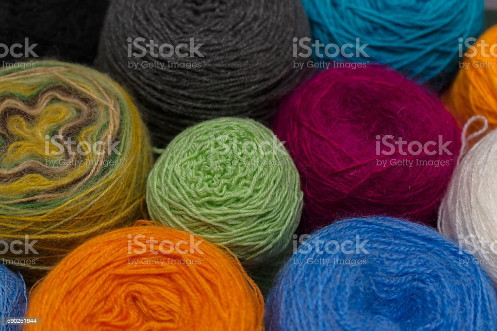 Many small balls of wool  rainbowcolors on the wooden table. stock photo