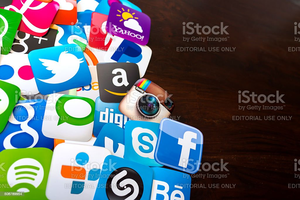 Many Social media icons printed on paper stock photo