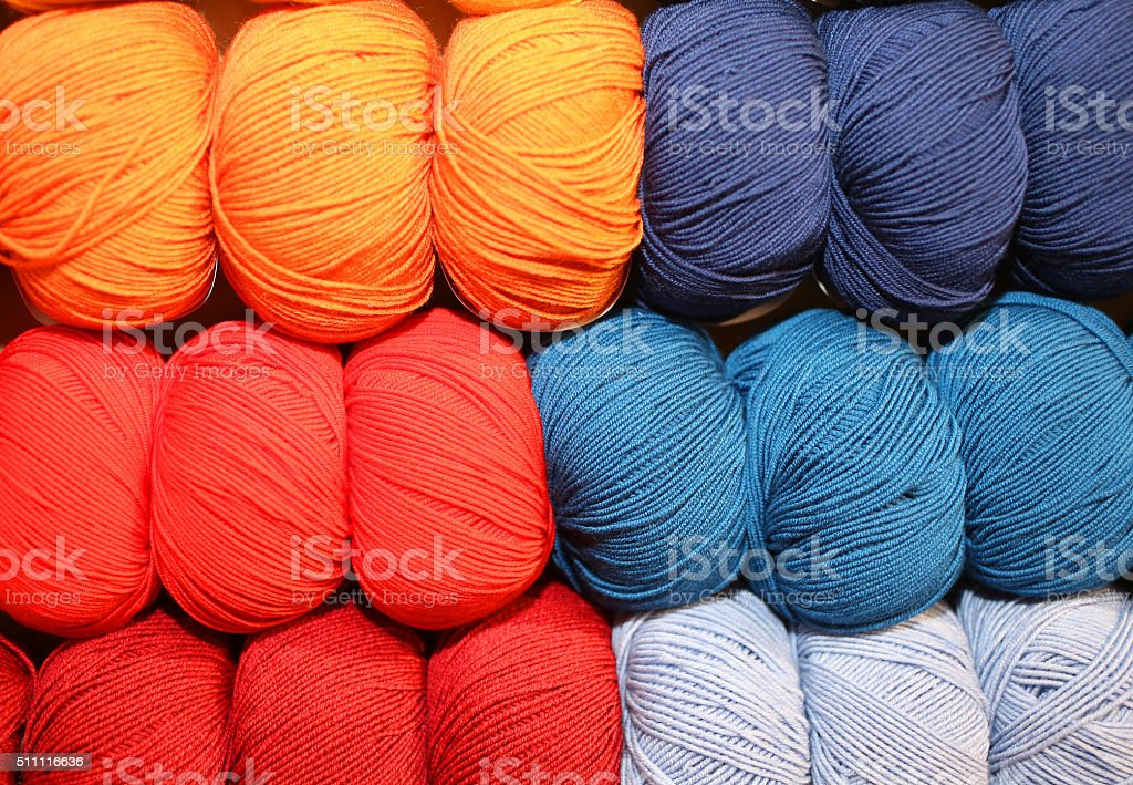 many soft balls of colored wool to create handmade sweaters stock photo