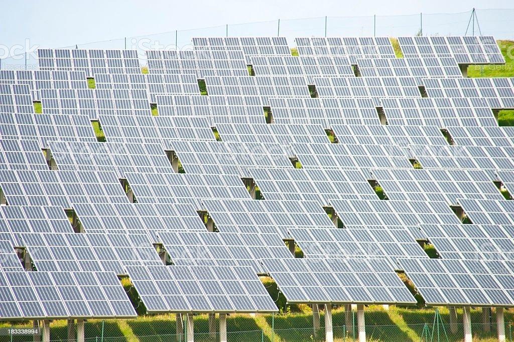 many solar panels in a row royalty-free stock photo