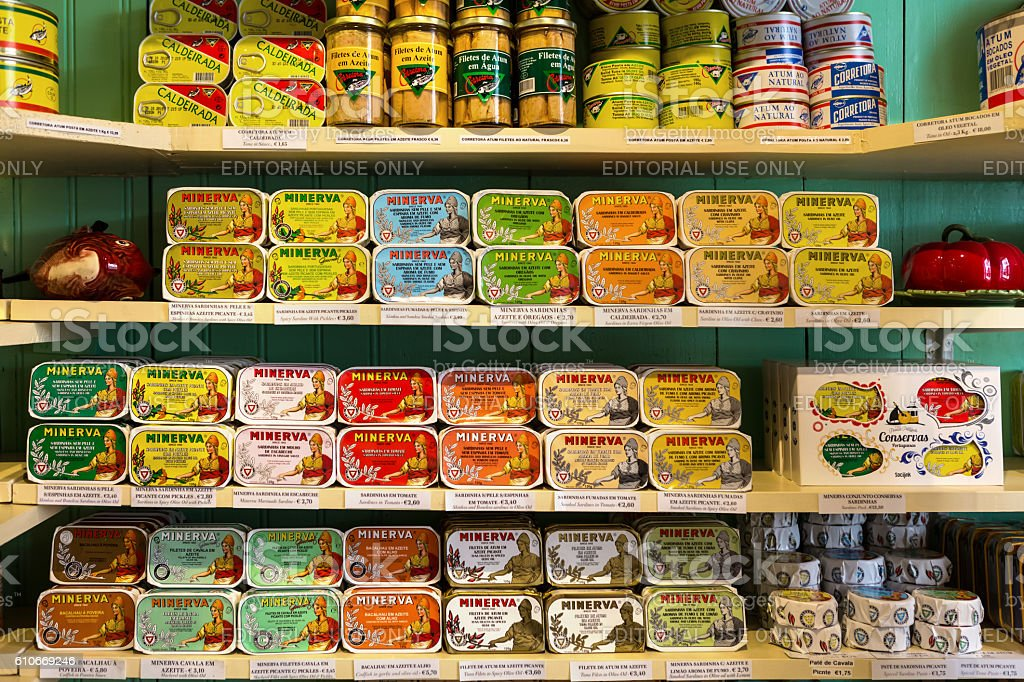 many sorts of canned fish in the shop stock photo