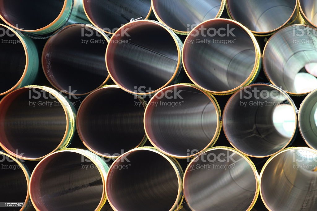 Many Steel pipes in large stack stock photo