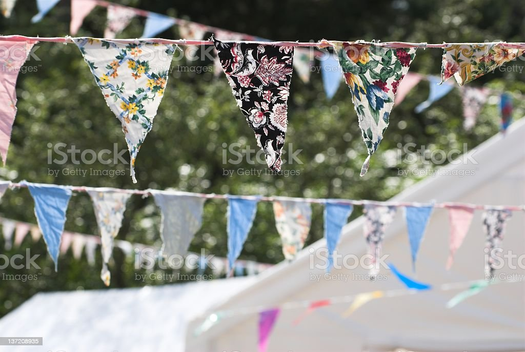 Many strands of floral bunting outside stock photo