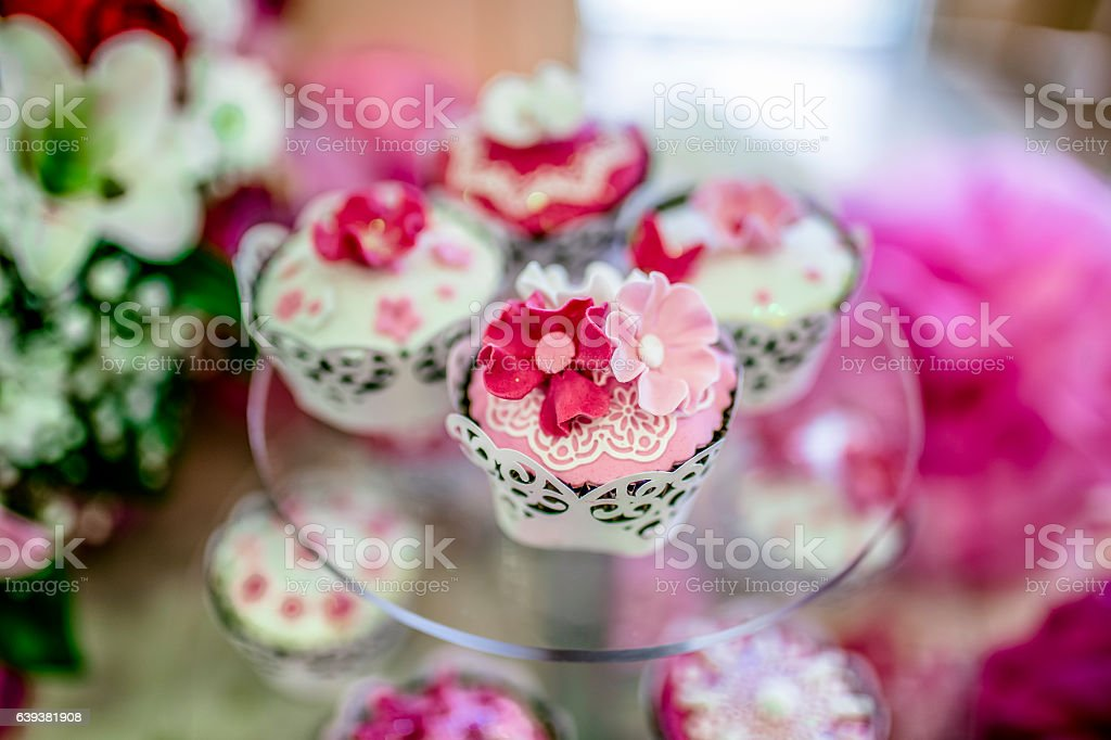 many sweet birthday cupcakes with flowers stock photo