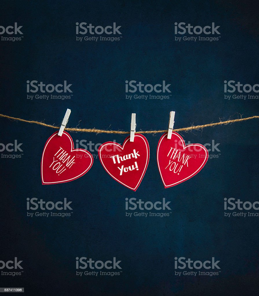 Many thanks! Three handmade hearts with thank you messages stock photo