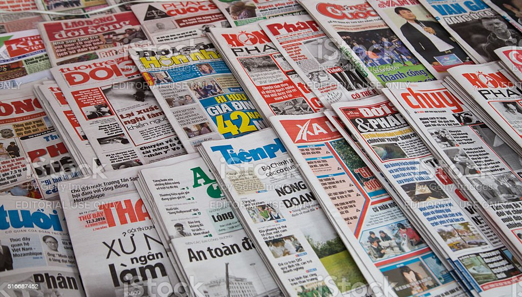 Many title of Vietnamese newspapers for sale stock photo