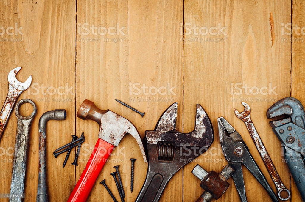 Many tools on wooden background stock photo