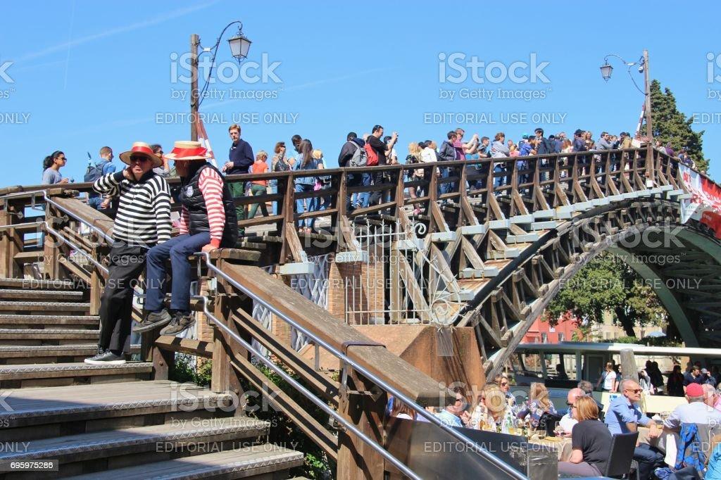Many tourists on the bridge ponte dell Accademia, Venice, Europe. stock photo