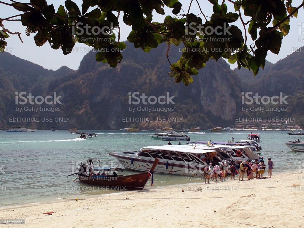 Many Tourists Stepping Out Of Boat At Tonsai Bay Thailand stock photo