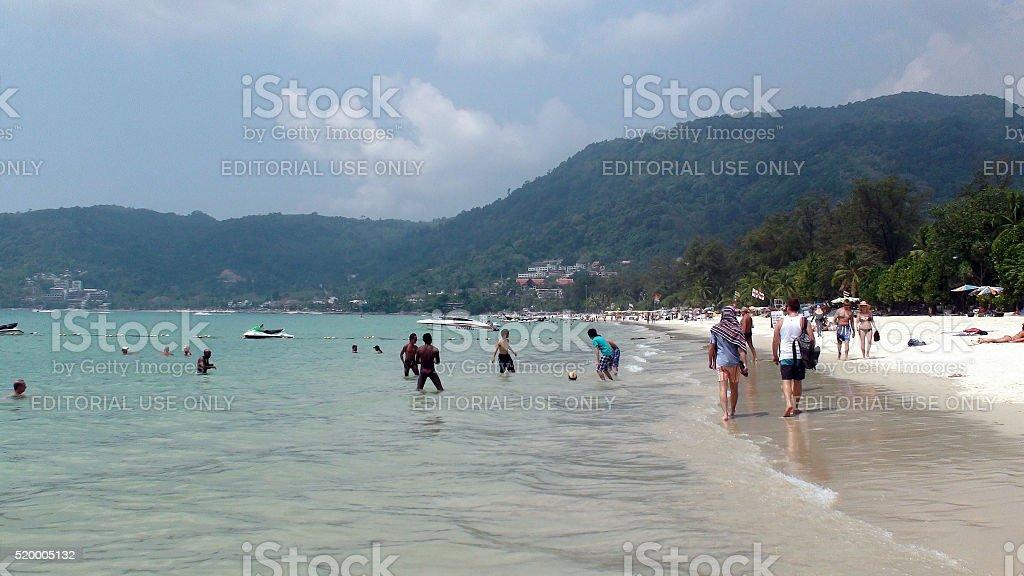 Many Tourists Swimming,Walking,Playing Soccer At Patong Beach Phuket.Thailand.Asia stock photo