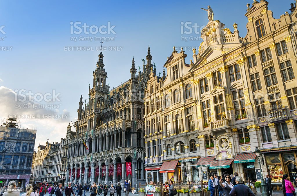 Many tourists visiting famous Grand Place of Brussels. stock photo