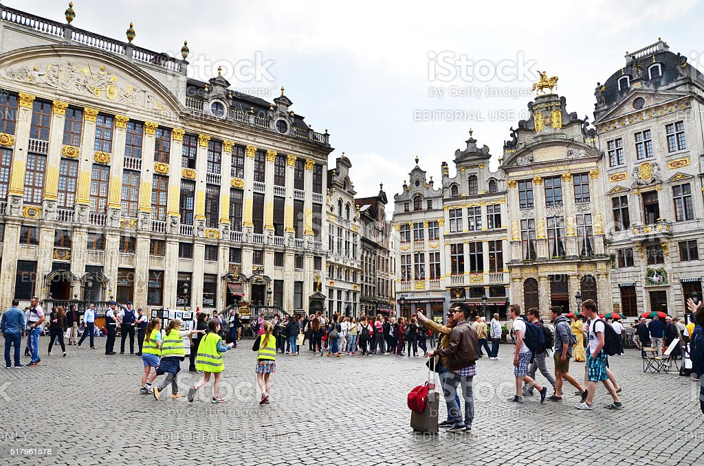 Many tourists visiting famous Grand Place of Brussels stock photo