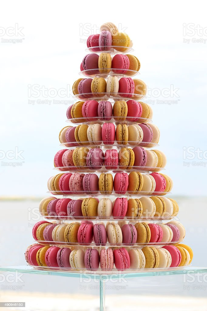 Many traditional french colorful macarons in a cake stand on stock photo