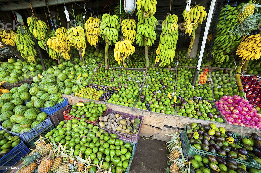 Many tropical fruits in outdoor market royalty-free stock photo