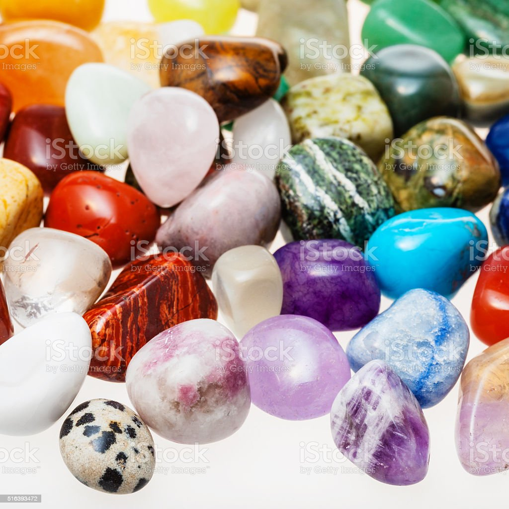 many tumbled natural mineral gemstones stock photo