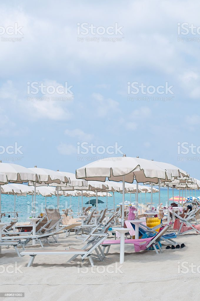 Many umbrellas and chairs at a resort in southern Italy stock photo