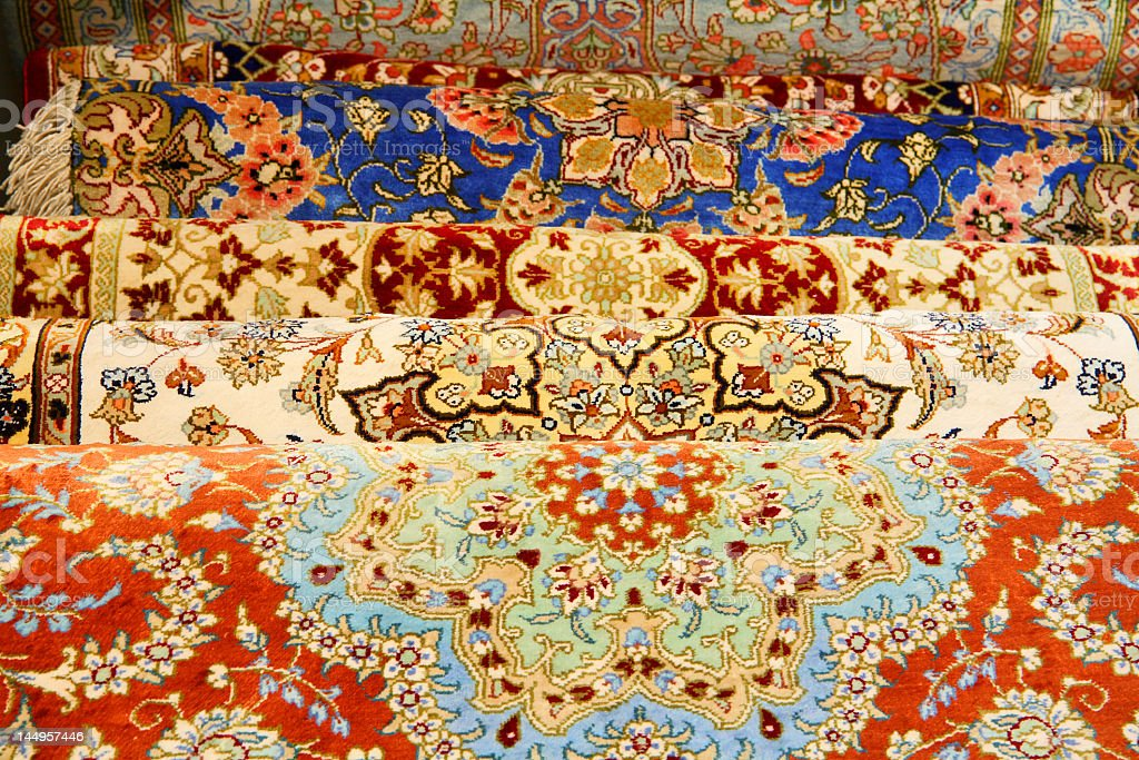 Many vibrant multicolored Persian carpets stock photo